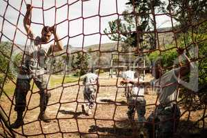 Soldiers performing training exercise on net
