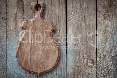 wooden kitchen board hanging on a wooden old wall