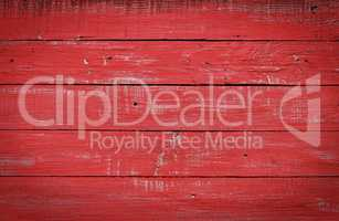 Red wooden background of boards