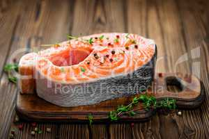 Salmon fish steak on wooden background