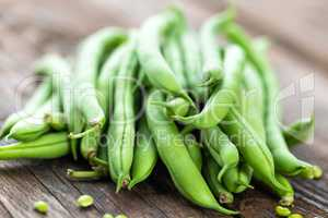Fresh green beans on dark wooden rustic background