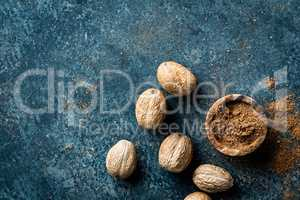 Nutmeg on dark background directly above copy space