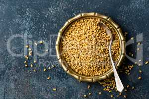 Fenugreek seeds on metal plate, spice, culinary ingredient
