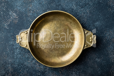 Empty metal plate on dark texture background top view, copy space