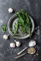 Rosemary, garlic, salt and white pepper, culinary background with various spices, directly above, flat lay