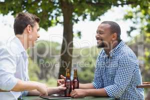 Friends having a conversation while having beer
