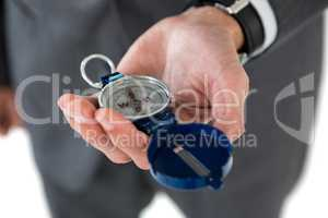 Mid section of businessman holding compass
