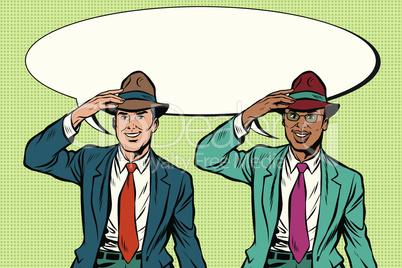 Joyful white and black businessmen in retro hats