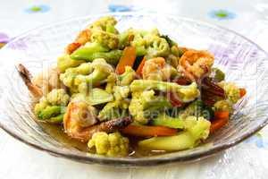 Stir-fry vegetables and shrimp.