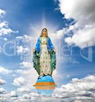 Virgin mary statue at the sky background.