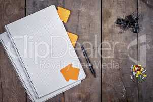 Open empty notebook on a brown wooden surface