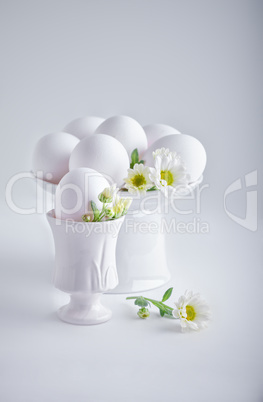 Eggs with flowers on a white background. Easter Symbols