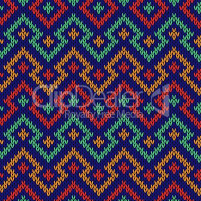 Knitting seamless geometric colour pattern