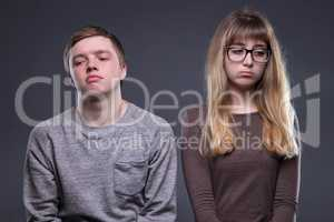 Offended young woman and man