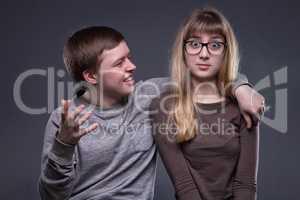 Flirting young man and teenage gir