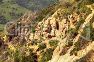 Coyote den cave in a mountainside