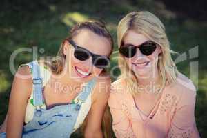 Beautiful women wearing sunglasses in park