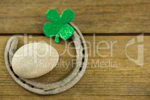 St Patricks Day shamrocks with horseshoe and pebble