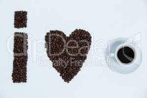 Coffee beans and cups forming I love, addiction coffee