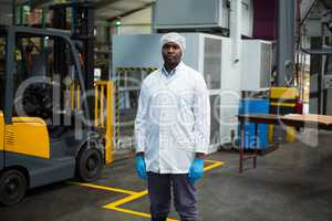 Factory engineer standing in bottle factory