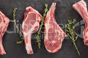 Rib chop and herb on black slate plate