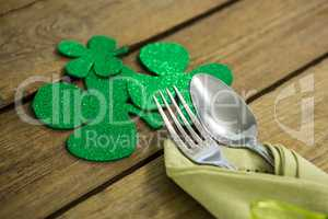 St Patricks Day fork and spoon wrapped in napkin with shamrocks