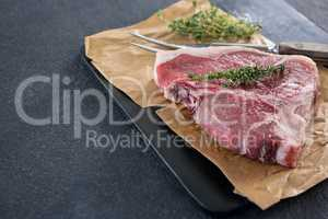 Sirloin chop and fork on slate plate