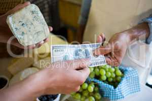 Staff receiving payment from the customer in market