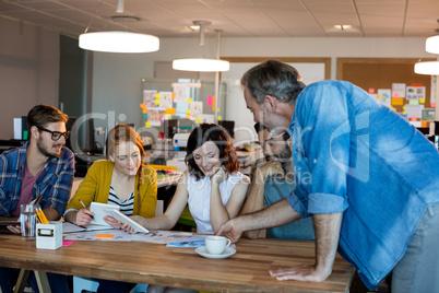Creative business team having a meeting at desk