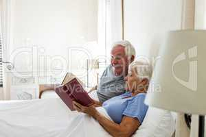 Senior couple reading books in the bedroom