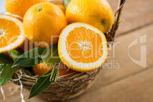 Close-up of oranges in wicker basket