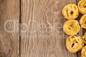 Fettuccine pasta arranged in a row