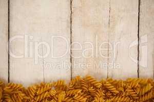 Girandole pasta on wooden background