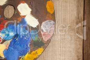 Palette with multiple colors on wooden table