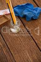 Paint brush in a jar filled with water and cloth