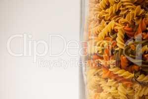Girandole pasta in a glass container