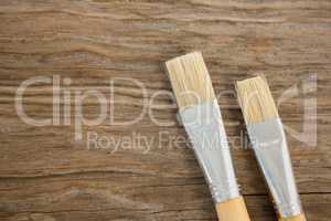 Flat brushes on wooden surface