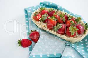 Fresh strawberries in wicker tray