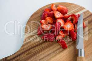 Slices of strawberries on chopping board