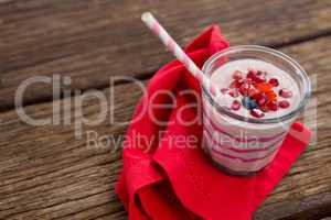 Fresh glass of smoothie with straw