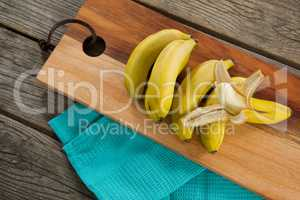 Overhead of fresh bananas on chopping board