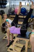 Two women exercising on wunda chair