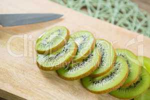 Slices of kiwi on chopping board