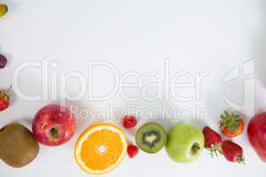 Various types of fruits arranged on white background