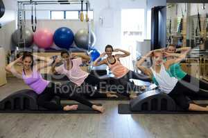 Group of women exercising on arc barrel