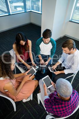 Creative business team using digital tablet