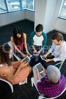 Creative business team using digital tablet