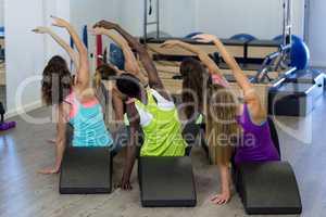Group of women exercising on arc barrel