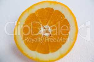 Ripe tasty orange cut into halves