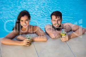 Portrait of young couple relaxing in the pool
